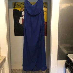 Blue floor length strapless dress.